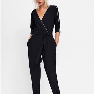 Zara black jumpsuit with contrasting piping